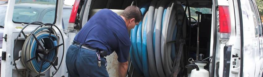 Disaster restoration professional preparing equipment