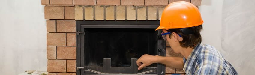 Home inspector inspecting fireplace
