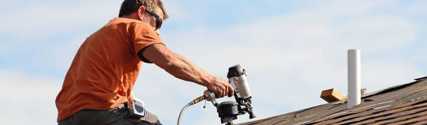 Roofing contractor fixing shingles