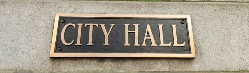 City Hall sign on small town government building