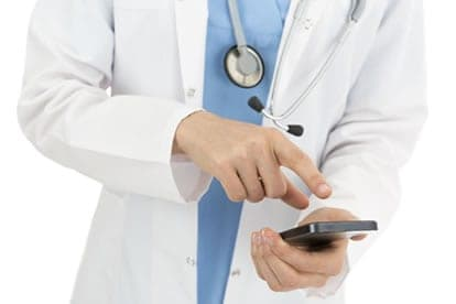 Healthcare worker receiving smartphone notification from contact center