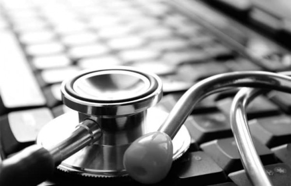 Physician's stethoscope on top of keyboard representing medical answering services by Continental Message Solution