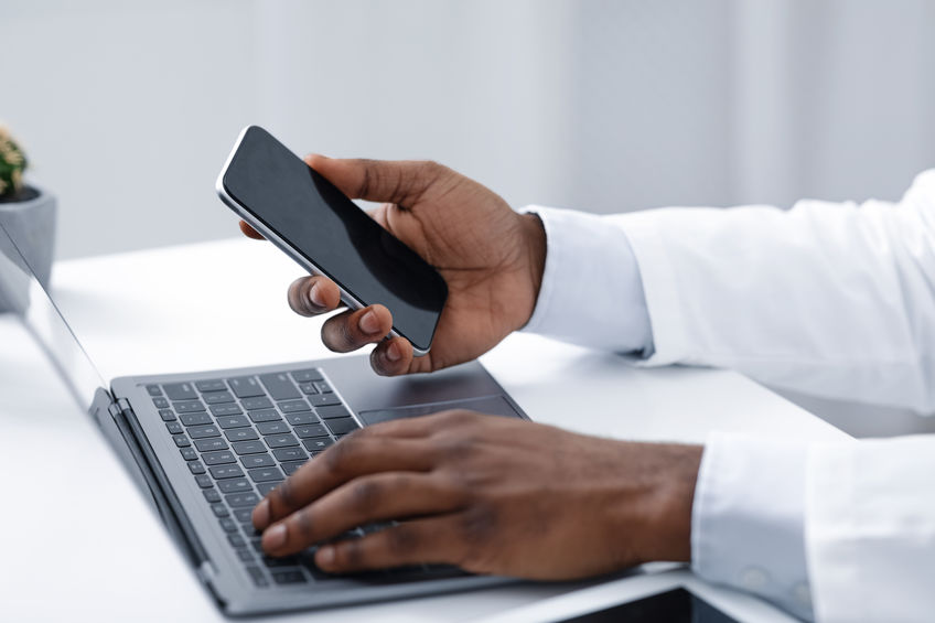 On-call oncologist checking for messages from the answering service