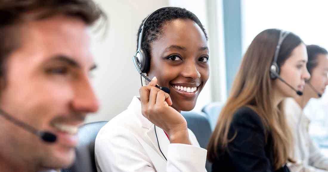 Call center operator taking calls on an employee attendance hotline